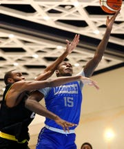 Memphis Tigers forward Lance Thomas lays the ball up against Raw Talent Elite during their exhibition game at the Grand Hyatt Baha Mar's New Providence Ballroom on Sunday, August 18, 2019.