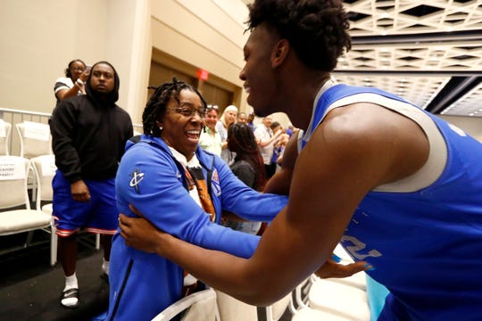 Memphis Tigers center James Wiseman greets his mom Donzaleigh Artis after their game against Raw Talent Elite at the Grand Hyatt Baha Mar's New Providence Ballroom on Sunday, August 18, 2019.