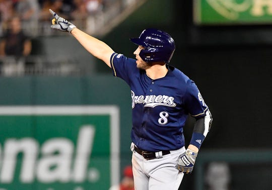 Brewers left fielder Ryan Braun celebrates his home run in the fifth inning. He also hit a go-ahead home run in the ninth inning.