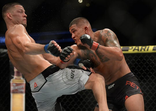 Anthony Pettis lands a punch against Nate Diaz Saturday night, but Pettis lost the UFC bout.