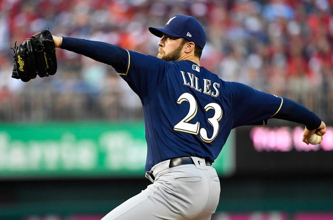 Brewers starting pitcher Jordan Lyles pitches in the second inning.