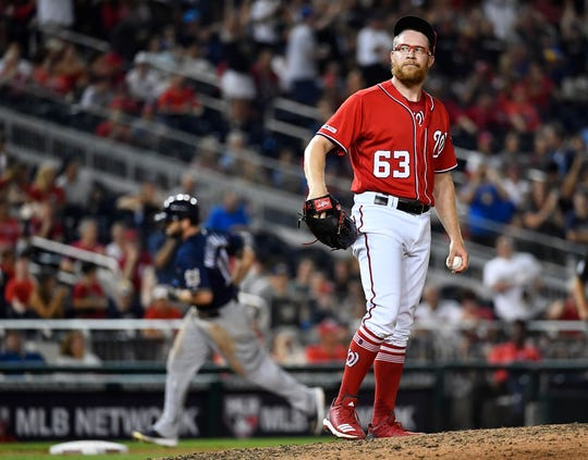 Nationals relief pitcher Sean Doolittle gave up four runs in the ninth inning, including a two-run home run to Mike Moustakas that ties the game.