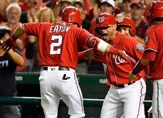 Adam Eaton is congratulated by center fielder Gerardo Parra (88) after hitting a three-run home run in the fourth inning
