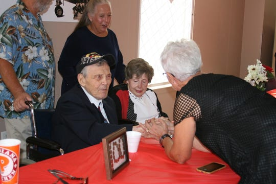 Henry Chodacki and his wife, Lee, visit with friends, family and fellow parishioners from St. Peter the Fisherman Catholic Church Saturday night. Approximately 200 people attended the celebration of Chodacki's 100th birthday.