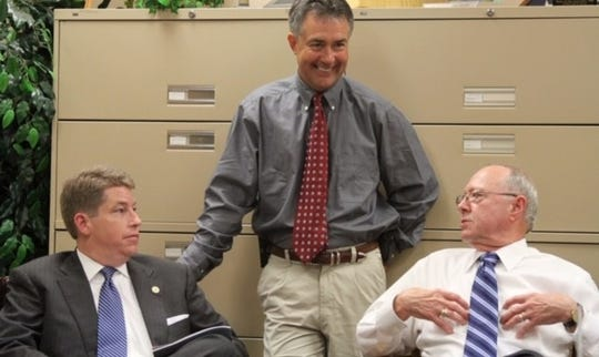 Former Prattville Mayors Jim Byard Jr., left, and Gray Price, right, visit Prattville Mayor Bill Gillespie in 2011.