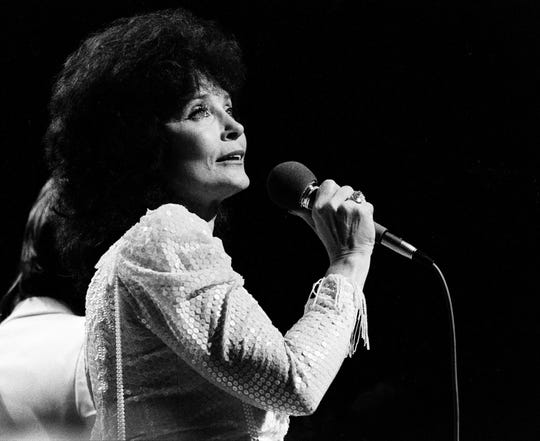 Loretta Lynn performs as a guest on the Grand Ole Opry stage Oct. 19, 1985, where host Roy Acuff returned after an absence of four months. A heart aliment had prevented the 82-year-old Acuff from performing.