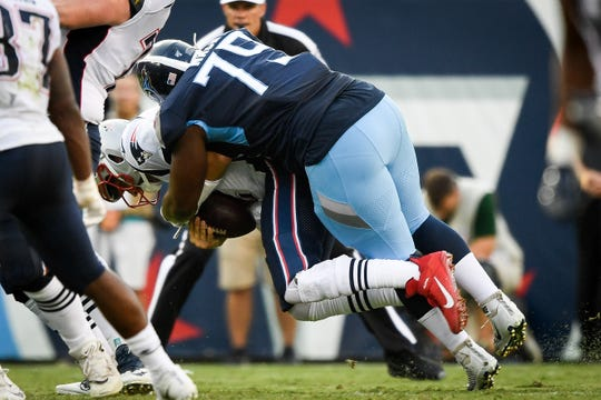 Tennessee Titans defensive tackle Isaiah Mack (79) tackles New England Patriots quarterback Brian Hoyer (2) during the first half at Nissan Stadium in Nashville, Tenn., Saturday, Aug. 17, 2019.