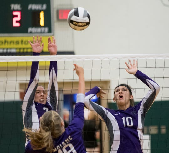 Granville Christian's Rachel Hill and Madison Holbert attempt to block against Mount Gilead during a match at Northridge on Saturday morning.