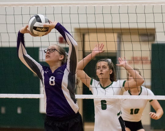 Granville Christian's Megan Austin sets during a match against Northridge Saturday afternoon.