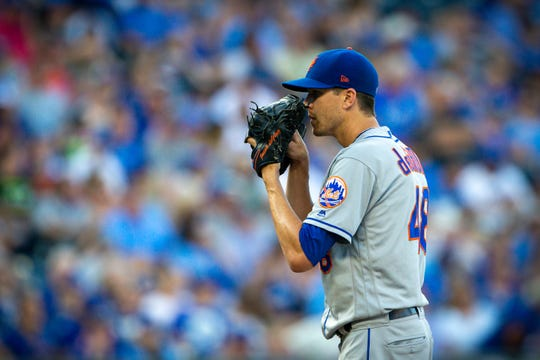 Aug 17, 2019; Kansas City, MO, USA; New York Mets starting pitcher Jacob deGrom (48) looks in for the sign during the first inning against the Kansas City Royals at Kauffman Stadium.