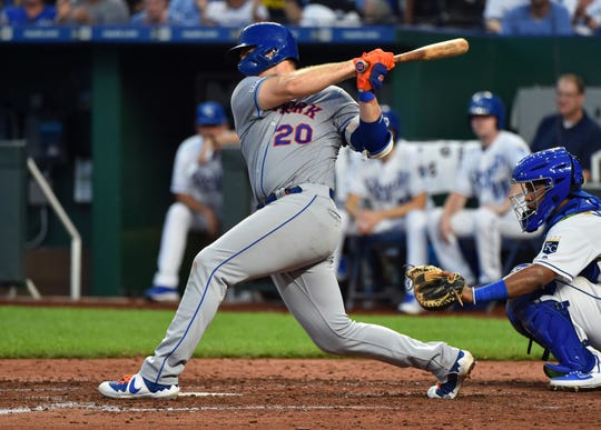 Pete Alonso #20 of the New York Mets hits a two-run single in the seventh inning against the Kansas City Royals at Kauffman Stadium on August 17, 2019 in Kansas City, Missouri.