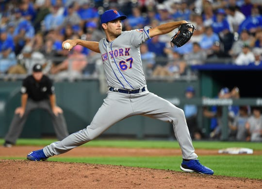 Relief pitcher Seth Lugo #67 of the New York Mets throws in the ninth inning against the Kansas City Royals at Kauffman Stadium on August 17, 2019 in Kansas City, Missouri.