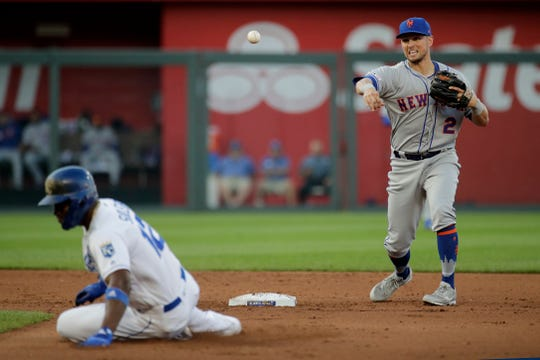 New York Mets second baseman Joe Panik (2) throws to first for the double play hit into by Kansas City Royals' Cheslor Cuthbert, after forcing out Jorge Soler (12) out at second during the fourth inning of a baseball game Saturday, Aug. 17, 2019, in Kansas City, Mo.