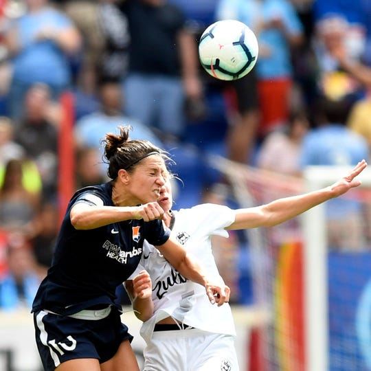 Sky Blue midfielder Carli Lloyd heads the ball against Reign FC in the second half. Sky Blue FC and Reign FC end in a tie, 1-1, at the Red Bull Arena on Sunday, August 18, 2019, in Harrison.