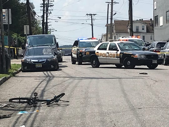 A man riding a bike was injured when he collided with a tow truck in Paterson on Sunday morning.