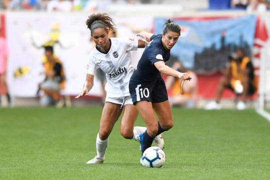 Sky Blue midfielder and New Jersey native Carli Lloyd (10) steals the ball from Reign forward Darian Jenkins, left, in the second half. The match between Sky Blue FC and Reign FC ends in a tie, 1-1, at the Red Bull Arena on Sunday, August 18, 2019, in Harrison.