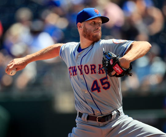 New York Mets starting pitcher Zack Wheeler delivers to a Kansas City Royals batter during the first inning of a baseball game at Kauffman Stadium in Kansas City, Mo., Sunday, Aug. 18, 2019. (AP Photo/Orlin Wagner)