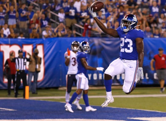 Aug 16, 2019; East Rutherford, NJ, USA;  New York Giants running back Jon Hilliman (23) scores a touchdown against the Chicago Bears during the second half at MetLife Stadium. Mandatory Credit: Noah K. Murray-USA TODAY Sports