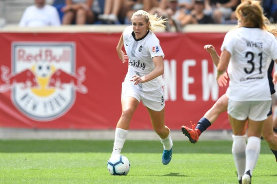 Reign FC midfielder and 2019 World Cup champion Allie Long plays against Sky Blue FC in the second half. Sky Blue FC and Reign FC end in a tie, 1-1, at the Red Bull Arena on Sunday, August 18, 2019, in Harrison.