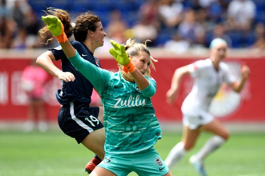 Sky Blue midfielder Elizabeth Eddy, left, watches as the ball goes into the Reign goal as goalie Casey Murphy misses the save. Sky Blue FC and Reign FC are tied, 1-1, at the half on Sunday, August 18, 2019, in Harrison.