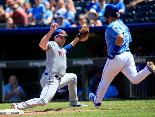 New York Mets first baseman Pete Alonso, left, forces out Kansas City Royals' Nick Dini (33) during the third inning of a baseball game at Kauffman Stadium in Kansas City, Mo., Sunday, Aug. 18, 2019. (AP Photo/Orlin Wagner)