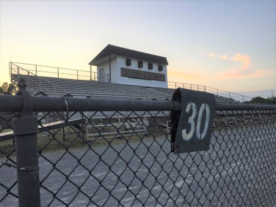 The downtown Plymouth football field's home grandstand and press box.