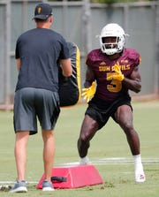 ASU running back Eno Benjamin (3) performs a drill during practice in Tempe August 18, 2019.