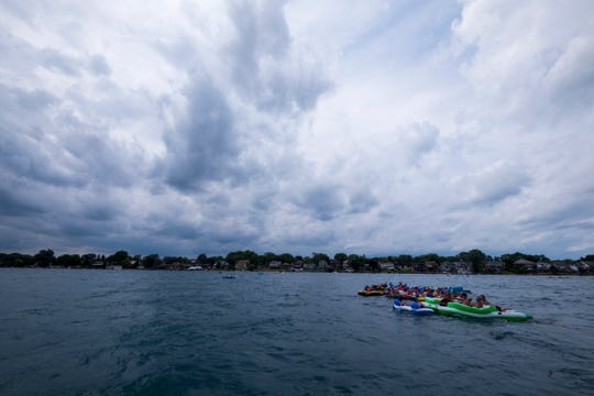 The weather begins to turn while visitors continue to float down the St. Clair River during the Port Huron Float Down on Sunday, April 18, 2019.