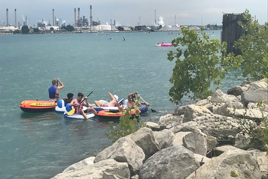 A group of Port Huron Float Down participants make their way to shore at the Blue Water River Walk on Sunday, Aug. 18, 2019. Many of the estimated 5,500 people in the water that day ended the miles-long journey early because of the weather.