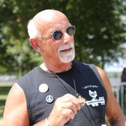 Josef Ferri from Buffalo, N.Y., arrives on the fourth and the final day of the 50th anniversary Woodstock celebration at Bethel Woods Center for the Arts in Bethel on Sunday, August 18, 2019.