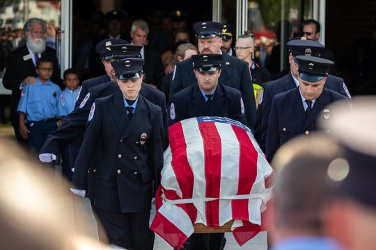 Pallbearers carry the casket of Buchanan Valley Fire Department Assistant Chief Walter Wagaman after his funeral service on Sunday, Aug. 18 at Gettysburg High School. Assistant Chief Wagaman died on Aug. 14 after sustaining severe injuries in the line of duty on Aug. 2 when he fell from a fire engine responding to a vehicle crash.