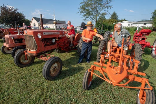 Tractor owners chat before worship at Lazarus United Church of Christ in Lineboro, Maryland. The church, located just over the Pennsylvania line, held the event for a second year to attract more worshipers.