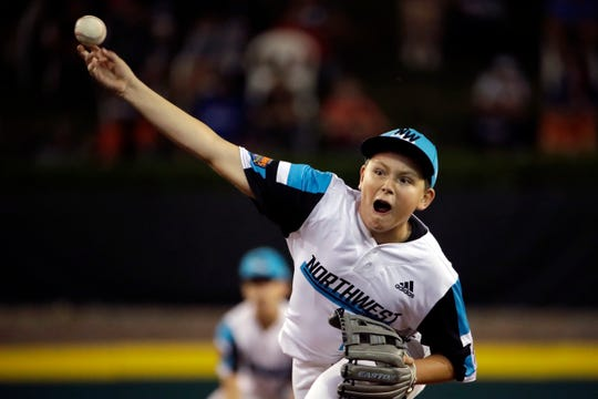 Salem, Ore., pitcher Avery Lohrman delivers during the first inning against River Ridge, La., at the Little League World Series baseball tournament in South Williamsport, Pa., Saturday, Aug. 17, 2019. Louisiana won 3-2.