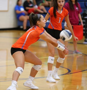 San Angelo Central's Mya Moore makes a dig during the Lady Cats' loss against defending champion Frenship in the Gold Bracket finals of the Nita Vannoy Memorial Volleyball Tournament at Lake View's Ben Norton Gym Friday, Aug. 17, 2019.