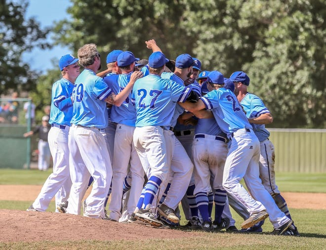 The Sioux Falls Brewers celebrate their 10-7 win over Yankton that made them state amateur baseball champions Sunday at Cadwell Park in Mitchell