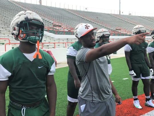 FAMU GA Todd Middleton points out defensive assignments during practice. He works primarily with the defensive linemen.