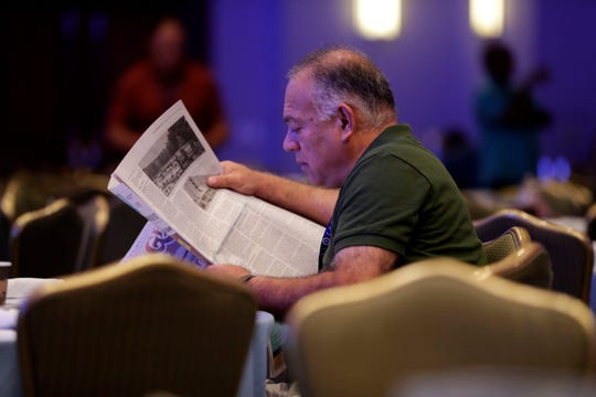 Steve Ghazvini catches up on the latest news before the start of the Tallahassee Chamber Conference closing session.