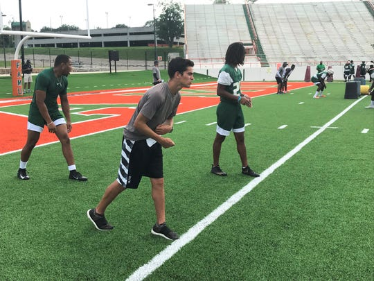 FAMU student assistant coach Colin Diaz works with the linebackers during practice.