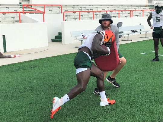 FAMU GA Mateo Kambui now works with the running backs. He braces for a hit from Bo Kendrick.