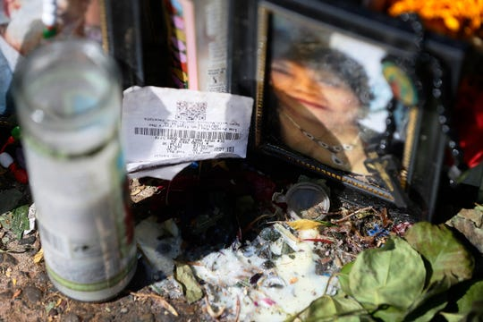 A receipt is laid next to a photo at the Walmart shooting memorial site Sunday, Aug. 18, in El Paso.