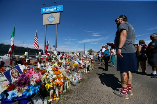 A procession of 22 hearses fills the Walmart shooting memorial site to honor all of the victims of the Aug. 3 attack Sunday, Aug. 18, in El Paso. The flowers were sent from across the world for the funeral services for Margie Reckard.