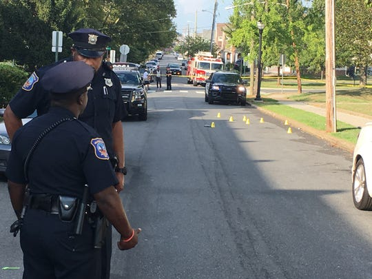 Police investigate a shooting in the 2200 block of Locust Street Sunday.