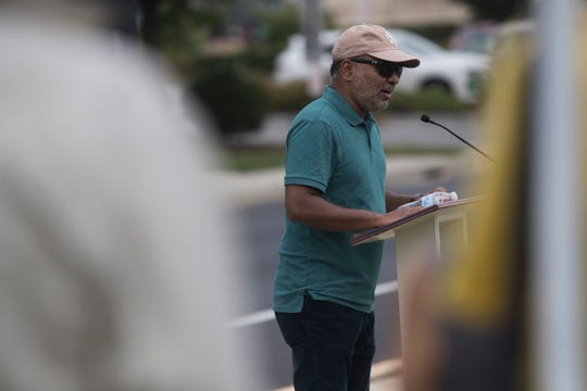 Irfan Patel with the Islamic Society of Delaware speaks to the crowd at Calvary Baptist Church Sunday in Newark.