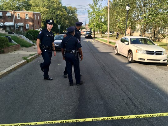 Police investigate a shooting in the 2200 block of Locust Street where they say a 22-year-old man was shot Sunday.
