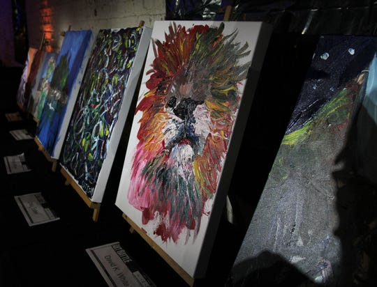 Completed art pieces made during Art Battle were set for sale in a silent auction Saturday, Aug. 17, 2019, in The Warehouse.