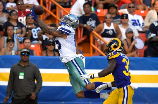 Dallas Cowboys wide receiver Devin Smith, left, makes a touchdown catch as Los Angeles Rams defensive back Darious Williams defends during the second half of a preseason NFL football game Saturday, Aug. 17, 2019, in Honolulu. (AP Photo/Mark J. Terrill)