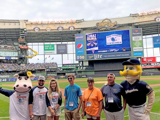 The Elbe family poses for photos with Bernie Brewer at the Milwaukee Brewers Farmer Appreciation Day on Aug. 11.