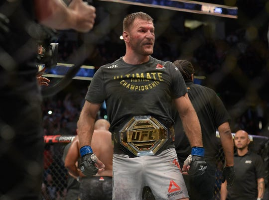 Stipe Miocic is awarded the championship belt following his TKO victory against Daniel Cormier during UFC 241 at Honda Center.