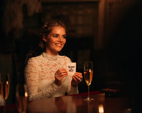 """A game of hide-and-seek goes south quickly for a new bride (Samara Weaving) in the horror comedy """"Ready or Not."""""""