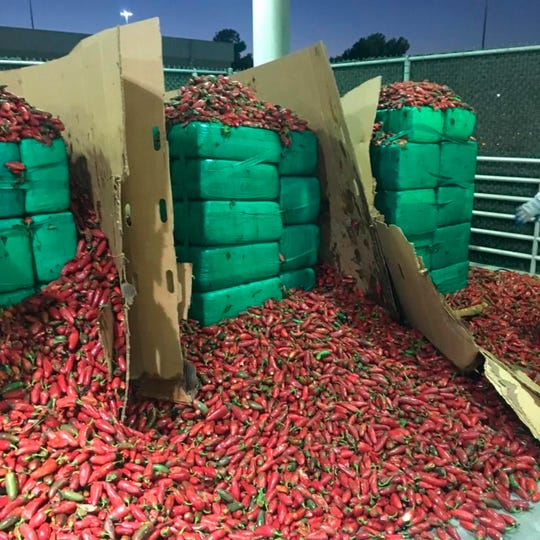 In this Thursday, Aug 15, 2019, photo released by U.S. Customs and Border Protection shows almost four tons of marijuana seized by Otay Mesa, CBP officers in Otay, Calif. Officials say they seized $2.3 million worth of marijuana mixed in with a shipment of jalapeño peppers at a Southern California port.